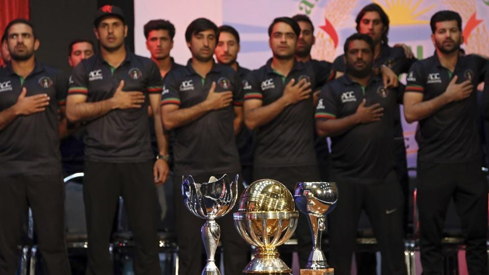 Afghanistan cricket team players stand for the national anthem during the celebrations. (AP)