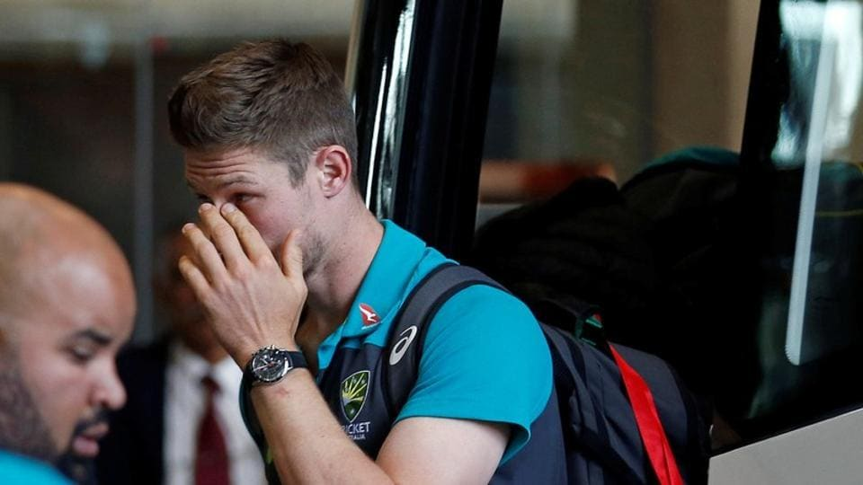 Australian cricketer Cameron Bancroft gestures as he arrives. (REUTERS)