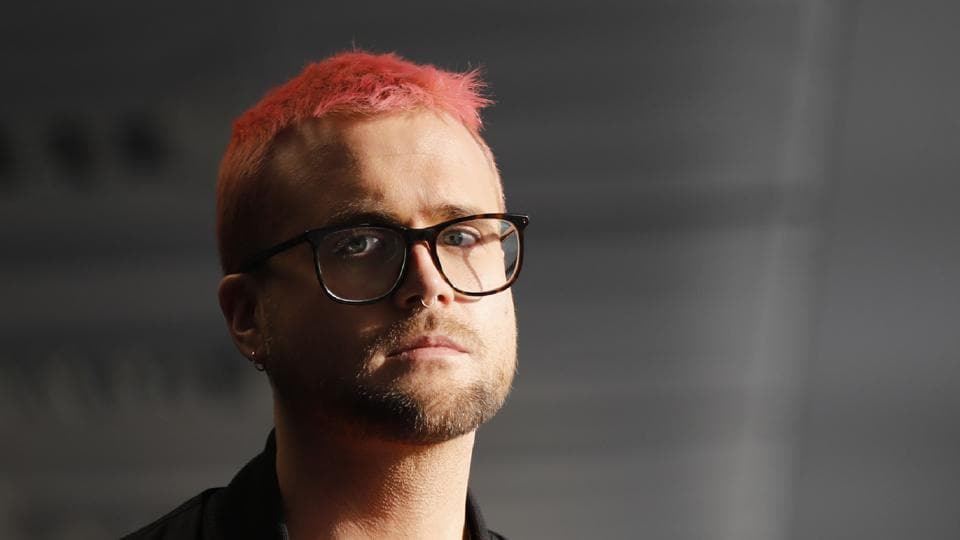 Canadian data analytics expert and whistleblower, Christopher Wylie poses for photographs outside a press conference in London on March 26, 2018.