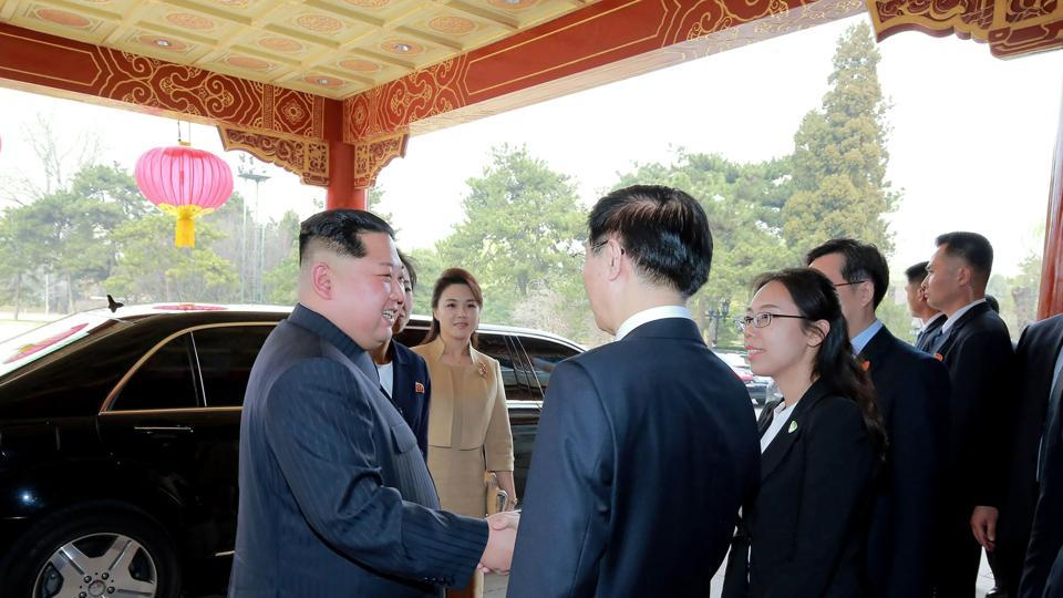 North Korean leader Kim Jong Un  and his wife Ri Sol Ju  being greeted by Chinese officials in Beijing, March 26.