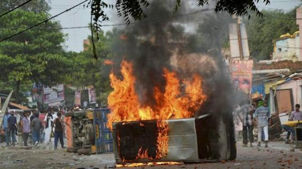 Vehicles set on fire after a clash between two communities in Kanpur.