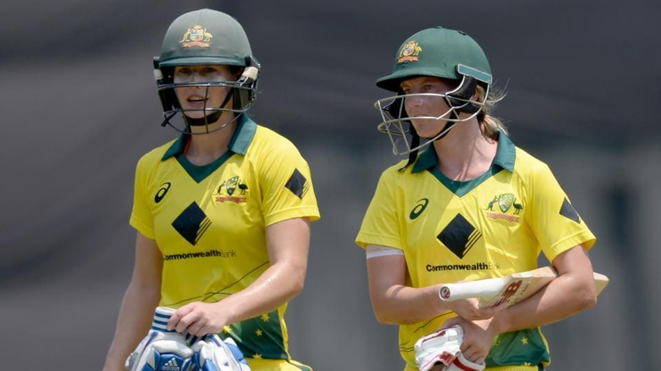 Australia cricketers Meg Lanning (R) and Ellyse Perry walk back to the pavilion after winning the fifth cricket match of the women's Twenty20 tri-series vs England at the Brabourne Stadium in Mumbai on Wednesday.