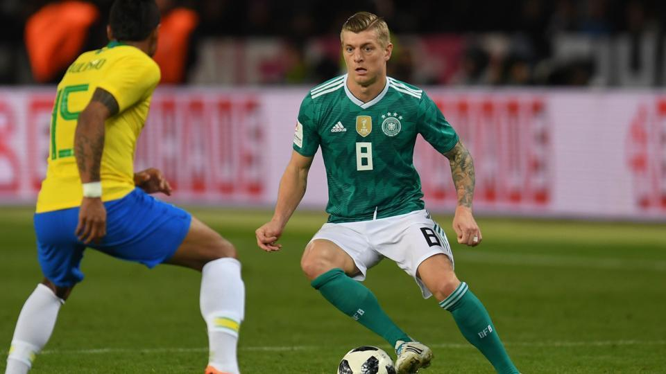 Germany's midfielder Toni Kroos (R) and Brazil's midfielder Paulinho vie for the ball during their international friendly football match in Berlin on Tuesday.