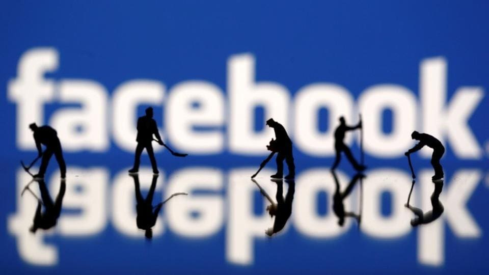 Figurines are seen in front of the Facebook logo in this illustration taken March 20, 2018.