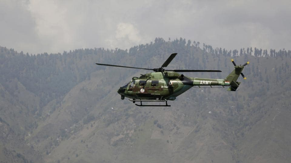 An Indian army helicopter flies over the army base in the town of Uri, west of Srinagar, Kashmir.