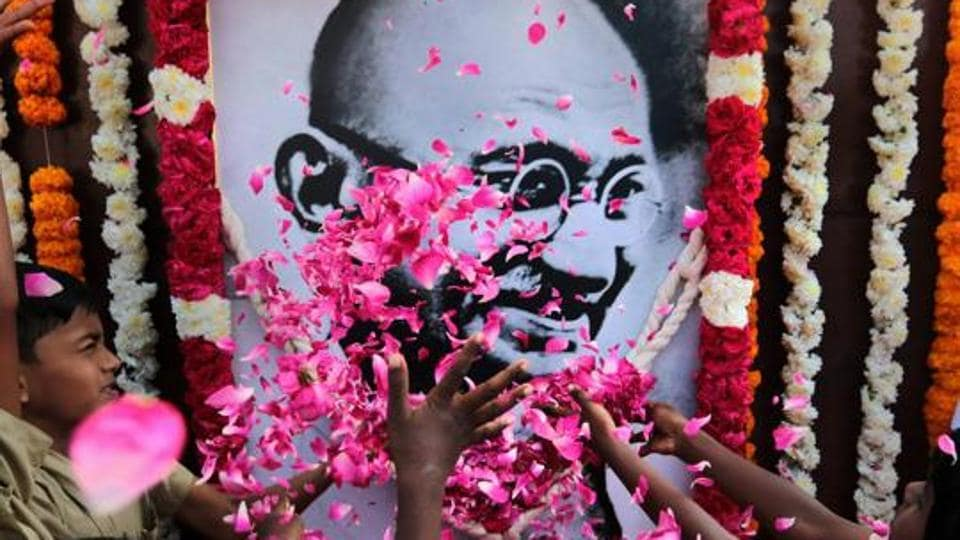 School children pay homage to a portrait of Mahatma Gandhi on his 70th death anniversary in Chennai on January 30, 2018.