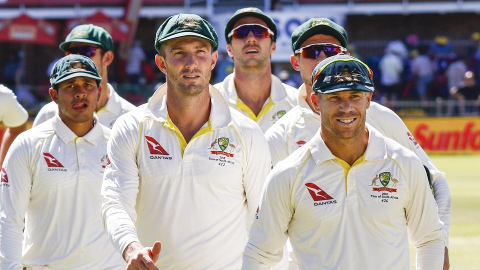 Australia's David Warner, right, leads his team off the field after losing the second cricket Test versus South Africa at St. George's Park in Port Elizabeth, March 12, 2018. Warner has been sent home by Cricket Australia in the wake of the ball-tampering scandal. LG has dropped him as a brand ambassador.