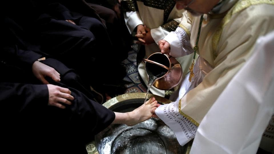 Archbishop Pierbattista Pizzaballa, Apostolic Administrator of the Latin Patriarchate of Jerusalem, performs the Catholic Washing of the Feet ceremony in the Church of the Holy Sepulchre in Jerusalem's Old City. (Corinna Kern / REUTERS)