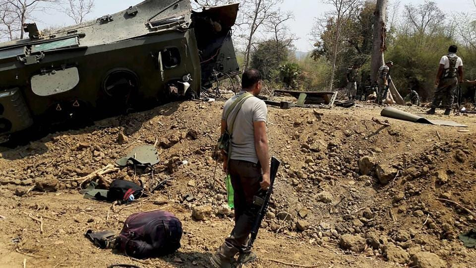 Security personnel inspect the site of an IED blast where nine CRPF personnel were killed and two more were injured after Maoists ambushed them in Kistaram area of Chhattisgarh's Sukma district on March 13, 2018. The government has been trying to build roads in the region to limit access of Maoists to potential recruits.