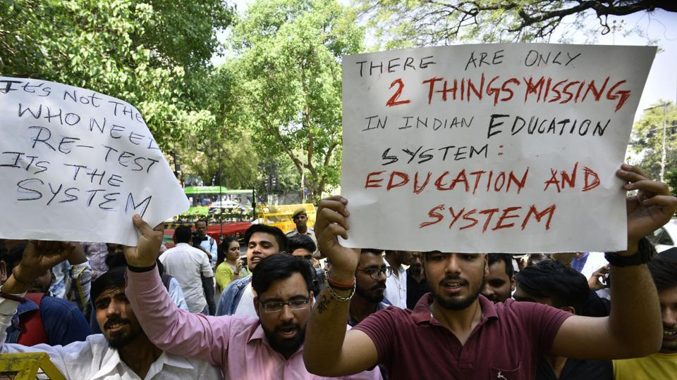 CBSE board students protest against the board for announcing the re-examination of the leaked papers near Jantar Mantar in New Delhi on Thursday.