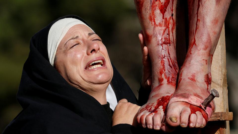 An actor, portraying Mary, takes part in an interactive Passion play in the grounds of Mount Carmel Mental Hospital in Attard, Malta. (Darrin Zammit Lupi / REUTERS)