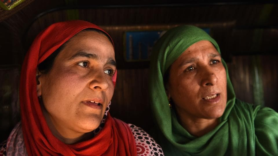 Kashmiri mother Maimoona (left), whose son Fahad Mushtaq was gone missing, speaks to journalists as she appealed for her son to return home at the Press Enclave in Srinagar on March 28, 2018.