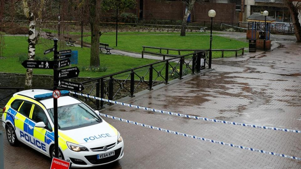 A police vehicle is parked next to cordon tape close to where former Russian intelligence officer Sergei Skripal and his daughter Yulia were found poisoned, in Salisbury, Britain, on Wednesday.