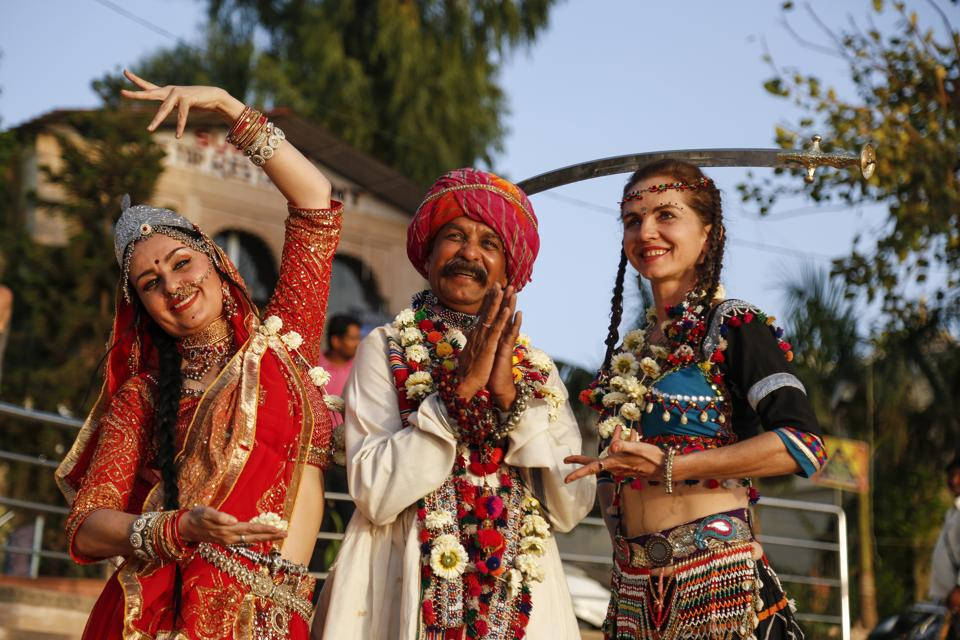 Foreign tourists learn Rajasthani dance at Pushkar  ahead of the state foundation day celebrations.
