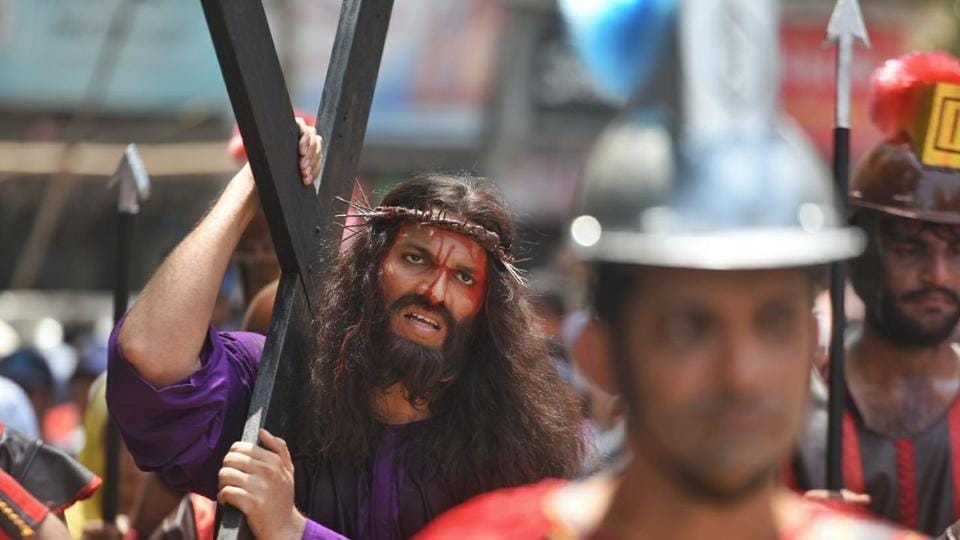 A procession from Sacred Heart Church, Santacruz West to St. Charles Convent, Vakola in Mumbai re-enacts Jesus Christ's crucifixion on the occasion of Good Friday. (Satyabrat Tripathy / HT Photo)