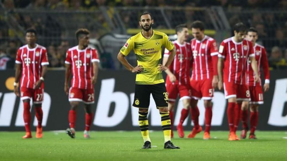 Borrusia Dortmund face Bayern Munich in a crucial Bundesliga encounter on Saturday.