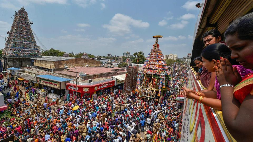 Devotees pull the chariot of Lord Shiva during the annual Panguni celebrations of the Mylapore Sri Kapaleeswarar Temple in Chennai, Tamil Nadu. (PTI)