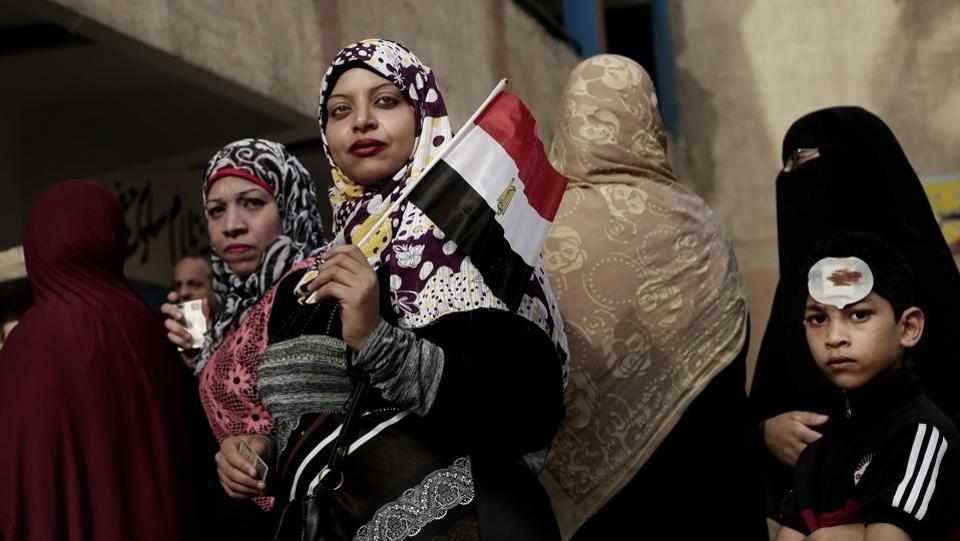 Women wait in line to vote outside a polling station at a school in the Omraniyah district of Giza, Egypt. Turnout appeared low as Egyptians voted in an election that President Abdel-Fattah el-Sissi is virtually certain to win, after all serious rivals were either arrested or intimidated into dropping out. (Nariman El-Mofty / AP)
