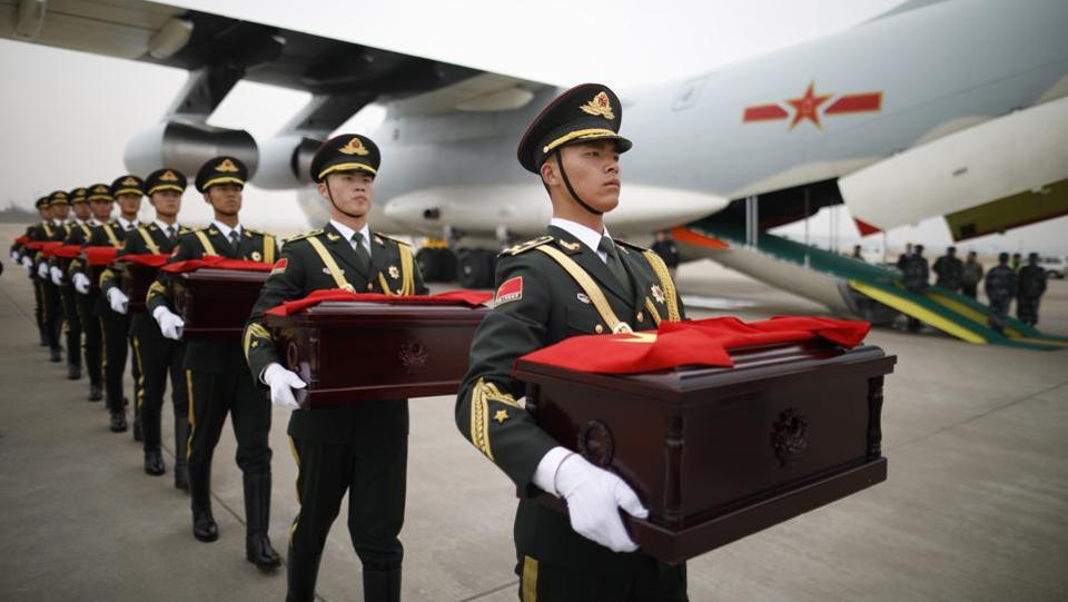 Chinese soldiers carry caskets containing the remains of Chinese soldiers who died in the Korean War, during the handover ceremony at the Incheon International Airport in Incheon, South Korea. (Kim Hong-Ji / Pool Photo via AP)