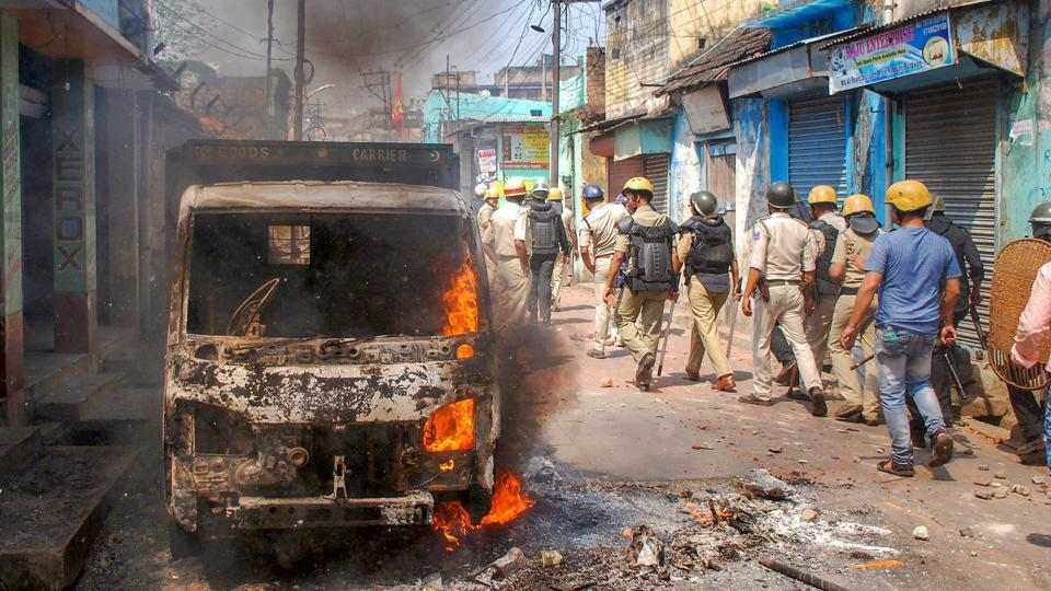 Police personnel patrol after clashes and incidents of arson over Ram Navami procession at Raniganj in Burdwan district, West Bengal. (PTI)