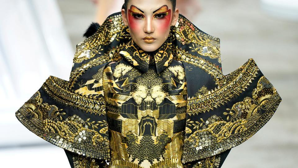 A model presents a creation for a make-up styling show by Mao Geping at China Fashion Week in Beijing, China. (Jason Lee / REUTERS)