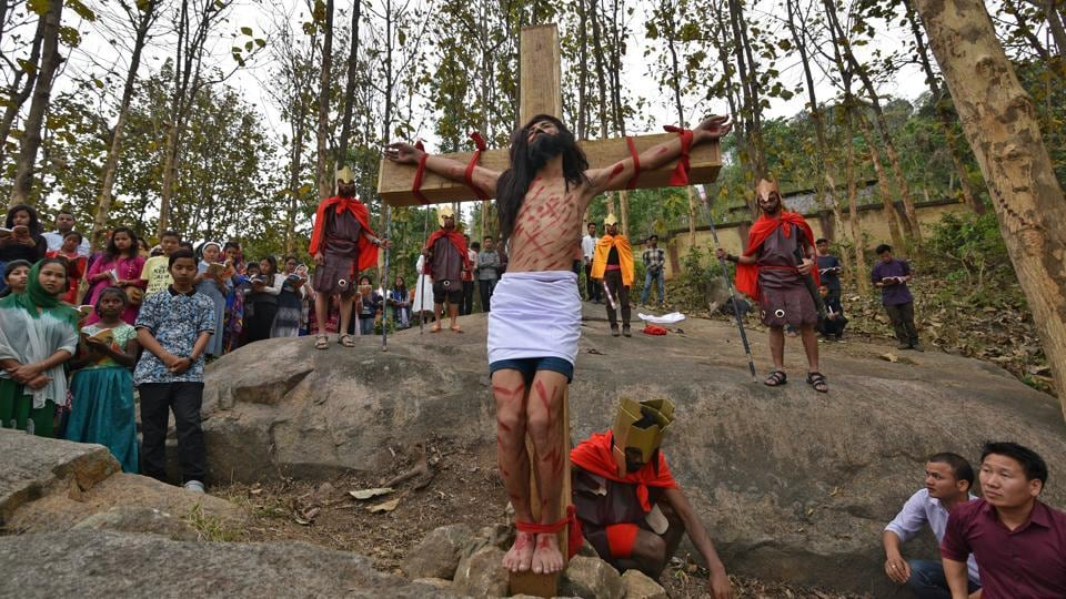 An man portraying Jesus Christ is tied to a cross during a re-enactment to mark Good Friday in Guwahati, Assam. (Anuwar Hazarika / REUTERS)