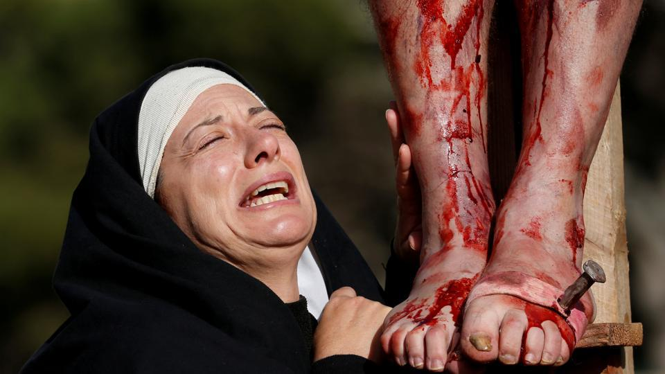 An actor, portraying Mary, takes part in the interactive street-theatre Passion play in the run-up to Easter, in the grounds of Mount Carmel Mental Hospital in Attard, Malta. (Darrin Zammit Lupi / REUTERS)