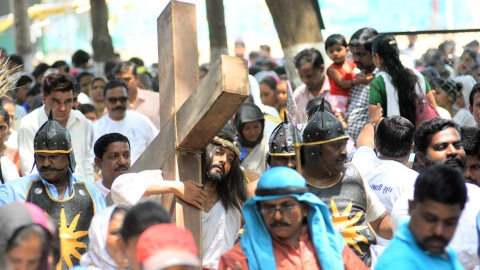 Don Bosco church members enact the part where Jesus carries the cross. in the city on March 30. (SHANKAR NARAYAN/HT PHOTO)