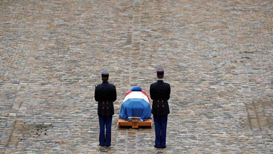 French Republican guards stand in front of the flag-draped coffin of Gendarmerie officer Colonel Arnaud Beltrame, who was killed by an Islamist militant after taking the place of a female hostage during a supermarket siege in Trebes, during a national ceremony at the Hotel des Invalides in Paris, France. (Christian Hartmann / REUTERS)