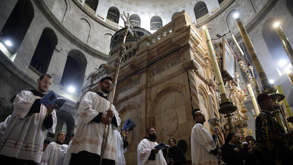 Catholic clergy circle the Edicule at the Church of the Holy Sepulchre, traditionally believed to be the site of the crucifixion and burial of Jesus Christ, in Jerusalem. (Mahmoud Illean / AP)
