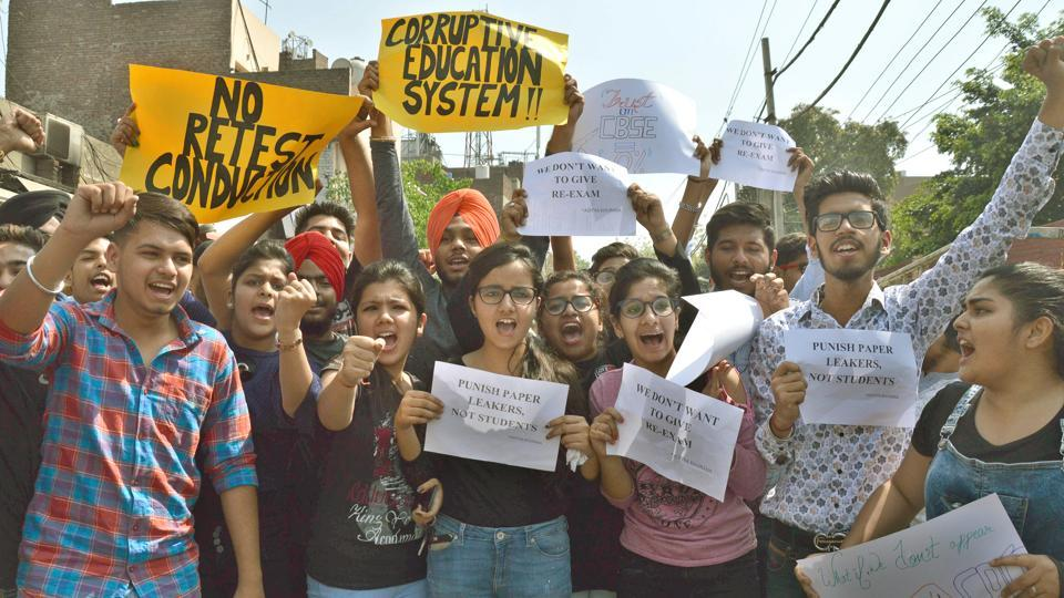 Students holding a protest against CBSE near CMC Hospital in Ludhiana on Friday.