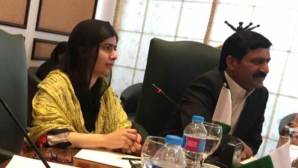 Malala at a meeting with Pakistani women's rights activists in Islamabad. She was forced out of her country after the Taliban shot her for attending school more than five years ago.