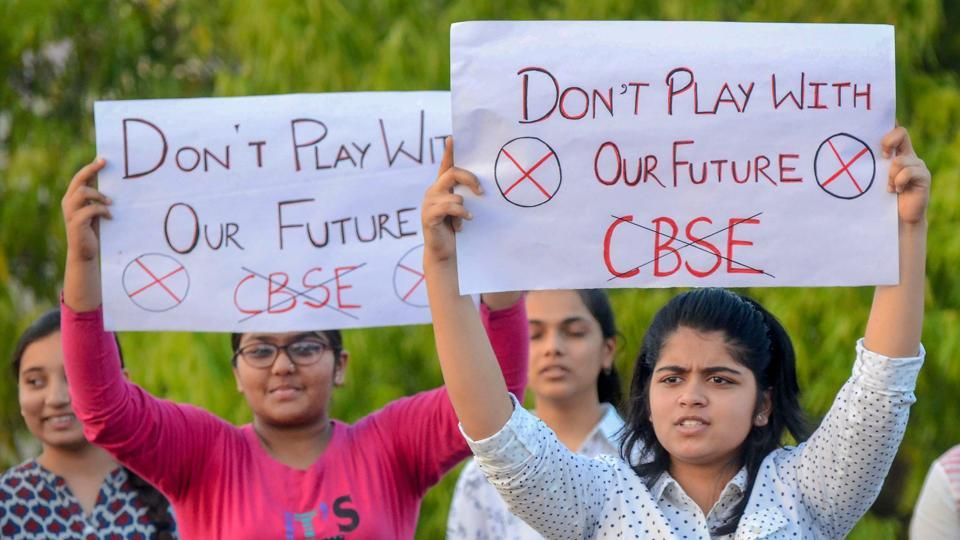 Central Board of Secondary Education (CBSE) students display placards during a protest over the alleged paper leak, in Jabalpur on Friday.