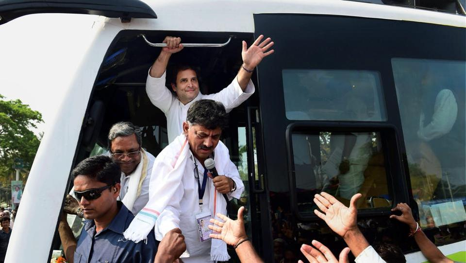 Congress President Rahul Gandhi greets supporters during a road show as a part of his Janashirvada Yatra from K R Pete to Pandavapura and Srirangapatna in Karnataka. (Shailendra Bhojak / PTI)