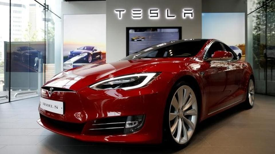 A Tesla Model S electric car is seen at a dealership store.