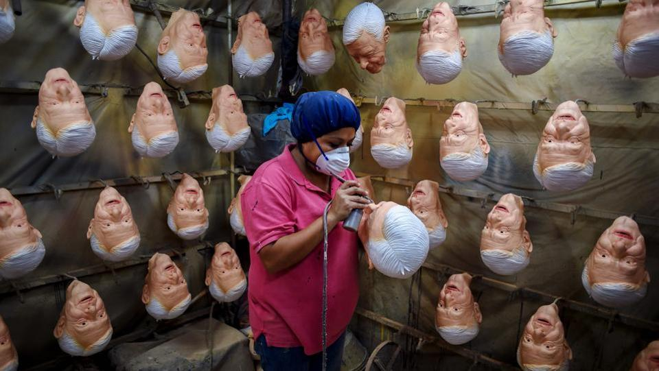 An employee gives finishing touches to a latex mask of Mexican presidential candidate Andres Manuel Lopez Obrador, of the MORENA party, at Rev, a factory in Cuernavaca, Morelos State, Mexico as the country prepares for general elections on July 1. (Alfredo Estrella / AFP)
