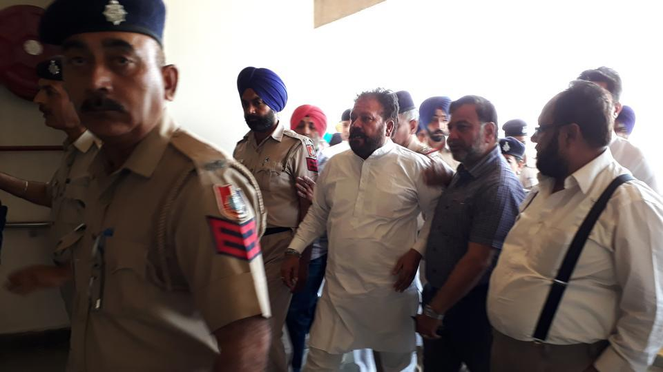 Congress councillor Devinder Singh Babla being taken to the district courts in Chandigarh on Saturday.