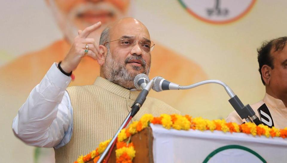 BJP national president Amit Shah addresses Dalit community leaders in Mysore on Friday.