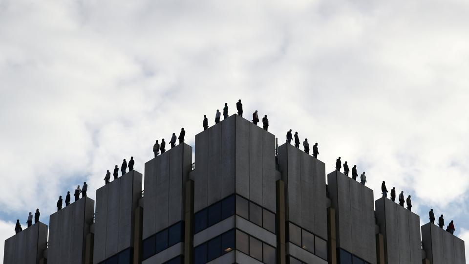 An art installation by US sculptor Mark Jenkins called 'Project 84', which aims to raise awareness of male suicide rates in the United Kingdom, is seen on the roof of a building in central London, Britain. (Hannah McKay / REUTERS)
