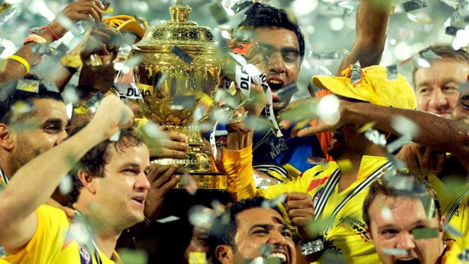 Chennai Super Kings celebrate with the trophy after winning the 2011 IPL final against Royal Challengers Bangalore. (AFP)