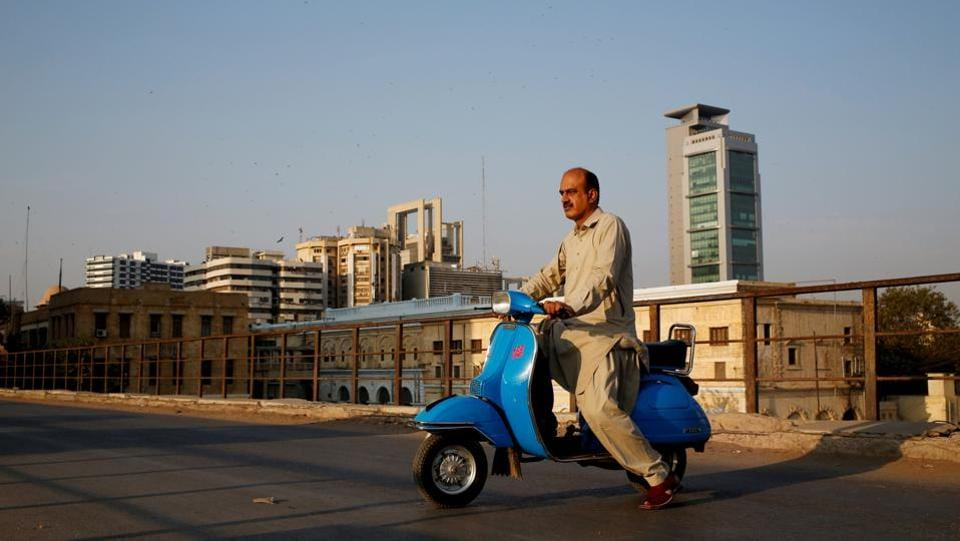 Journalist Arif Balouch, 48, poses with his heirloom 1980 model Vespa scooter that his father also rode, in Karachi. Balouch calls it the BMW of scooters. Piaggio's Italian two-wheeler was the ultimate status symbol for bike aficionados in the 1960s and 70s, when bicycles outstripped motorbikes on the roads and only a handful could afford to import luxury items from Europe. (Akhtar Soomro / REUTERS)