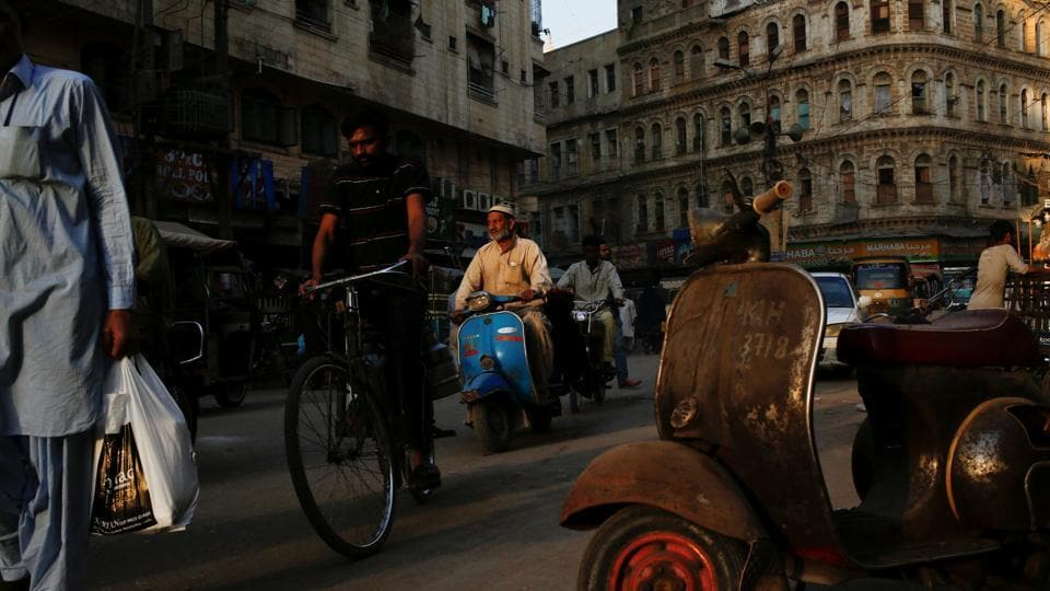 A man rides a Vespa scooter on a busy street, in a low-income neighbourhood in Karachi. Many long-term owners find that possessing a Vespa in Pakistan is a labour of love, with original spare parts scant and only a handful of mechanics skilled enough to restore the originals. (Akhtar Soomro / REUTERS)