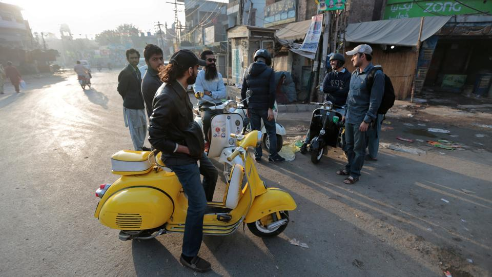 "Over the past two decades, motorbike ownership rates have skyrocketed in Pakistan, but for the likes of Zubair Ahmad Nagra, who runs the Vespa club in Lahore, new and more fuel-efficient bikes hold little allure. He drives a Vespa, Italian for ""wasp"", imported into Pakistan by his father in 1974. ""It was the first motorized vehicle owned by my father,"" Nagra said. ""I've been fond of it ever since."" (Caren Firouz / REUTERS)"