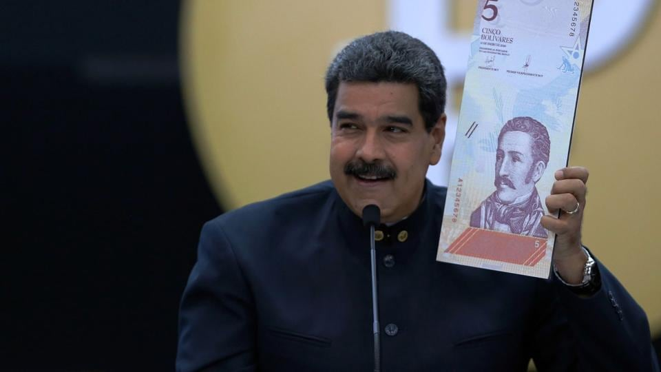 Handout photo released by the Venezuelan Presidency shows president Nicolas Maduro announce a new set of currency due to soaring inflation, on March 22, 2018.