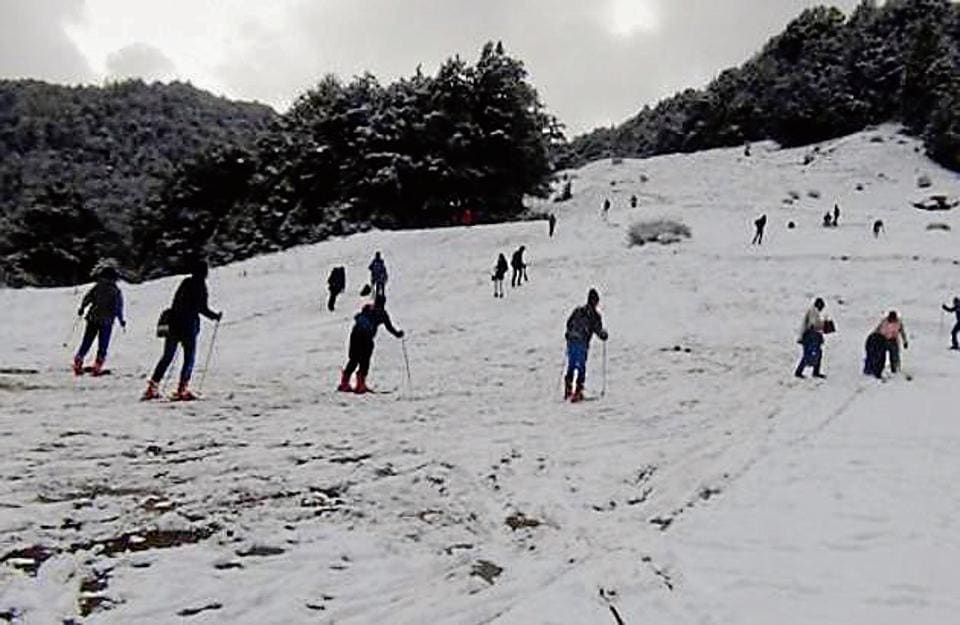Tourists enjoy at Auli Skiing slopes in Joshimath.