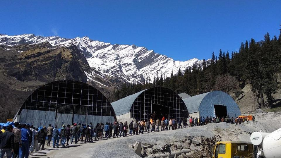 The protesting workers near the tunnel's south portal in Dhundhi, Kullu, on Sunday.