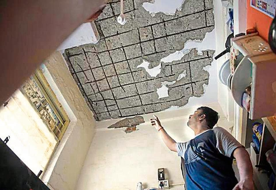 Government Colony resident Santosh Sawant shows the damaged ceiling of his house in Bandra on Saturday.