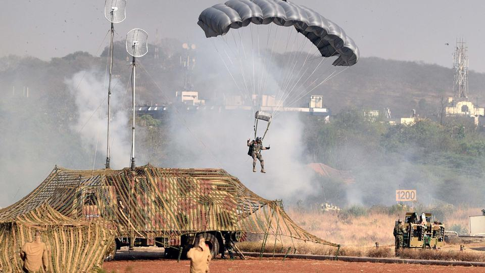 Army personnel enact combat situation during the 124th Raising Day of Southern Command Military Tattoo event at Race course in Pune on March 31.  (PRATHAM GOKHALE/HT PHOTO)