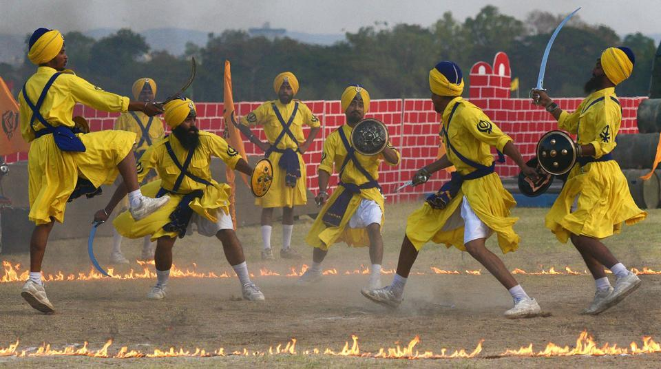 Army personnel perform Gatka, a martial art form of Punjab, during the 124th Raising Day of Southern Command Military Tattoo event at Race course in Pune on March 31. (PRATHAM GOKHALE/HT PHOTO)