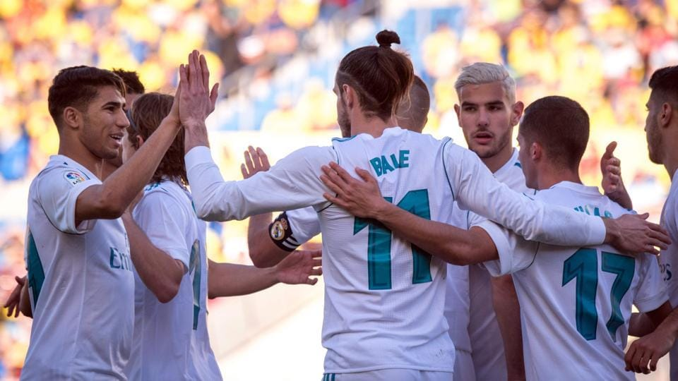 Real Madrid came one point close to Atletico Madrid in the La Liga with a convincing 3-0 win over Las Palmas.